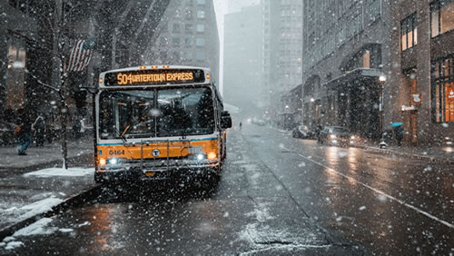 Passenger bus making a stop in snow.